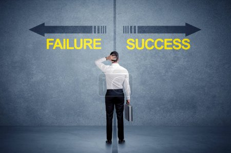 Businessman standing in front of success and failure arrow conce