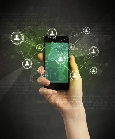 Photo for Caucasian hand in business suit holding a smartphone, social network concept - Royalty Free Image