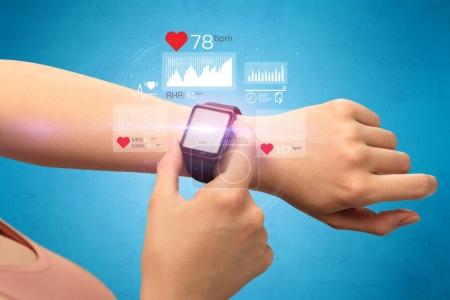 Photo for Female hand with smartwatch and health application icons nearby. - Royalty Free Image