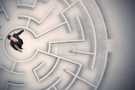 Photo for Confused business man trapped in a circular maze - Royalty Free Image