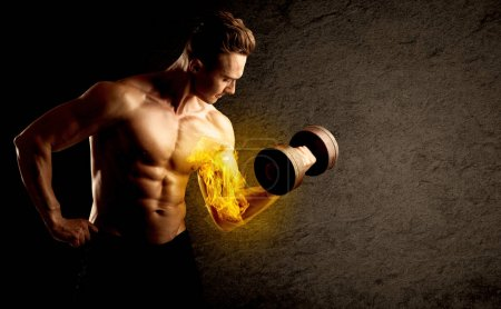 Muscular bodybuilder lifting weight with flaming biceps concept