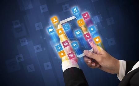 Photo for Female hand using smartphone with colorful angular fast switching application icons around - Royalty Free Image