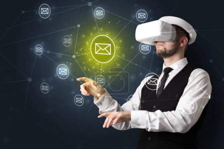 Photo for Young businessman in virtual reality glasses organize online network communication - Royalty Free Image