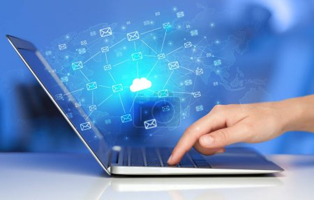 Photo for Hand using laptop with cloud computing and online storage concept - Royalty Free Image