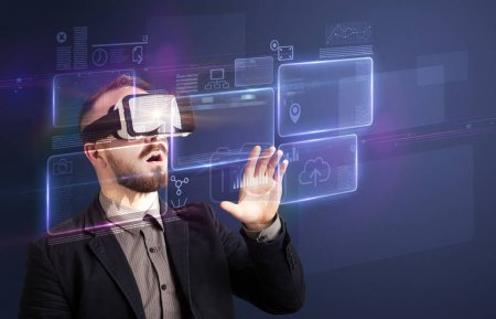 Photo for Amazed businessman with virtual reality charts and data in front of him - Royalty Free Image