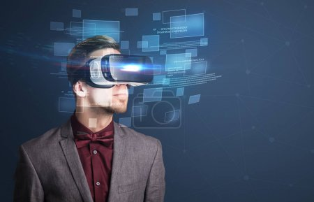 Photo for Amazed businessman with virtual reality data and blue squares in front of him - Royalty Free Image