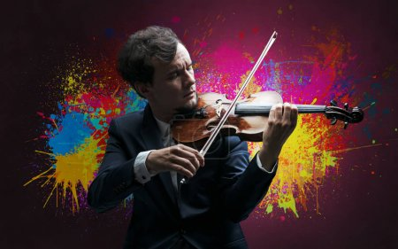 Photo for Young classical violinist musician with colorful splotch wallpaper - Royalty Free Image