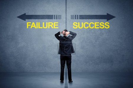 Photo for Businessman standing in front of success and failure arrow concept on grungy background - Royalty Free Image
