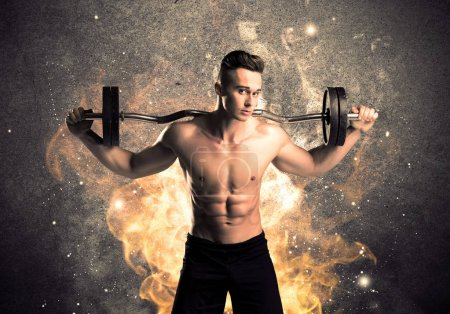 Healthy hot male showing muscles with fire