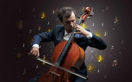 Photo pour Jeune violoncelliste avec chute musical notes papier peint et le concept classique - image libre de droit
