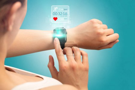 Photo for Female hand with smartwatch and running concept above. - Royalty Free Image