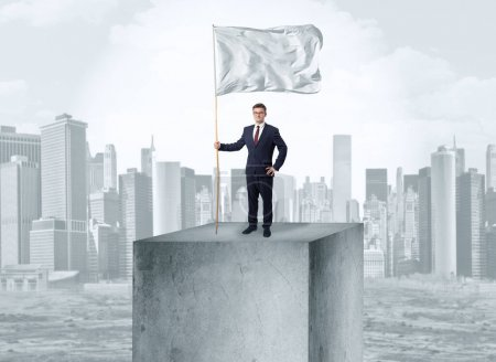 Photo for Handsome businessman on the top of the city with white flag - Royalty Free Image
