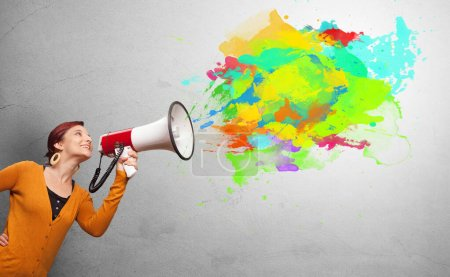 Photo for Person with megaphone and colorful splashes - Royalty Free Image