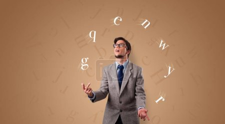 Photo for Young student juggle with letters - Royalty Free Image