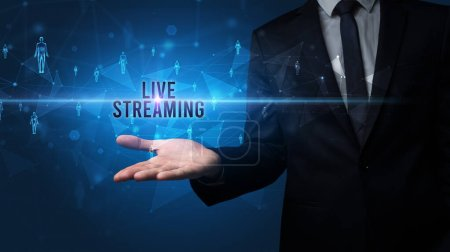Photo for Elegant hand holding LIVE STREAMING inscription, social networking concept - Royalty Free Image