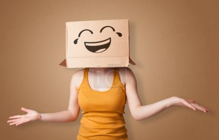 Funny woman smiling with cardboard box head