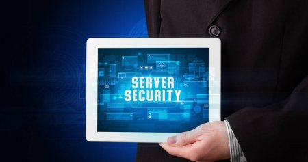 Photo for Young business person working on tablet and shows the digital sign: SERVER SECURITY - Royalty Free Image
