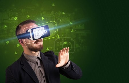 Photo for Businessman looking through Virtual Reality glasses with SOCIAL FORUM inscription, social networking concept - Royalty Free Image