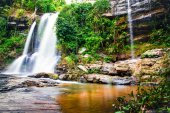 Waterfall in green forest in jungle,Maesapok village nature back