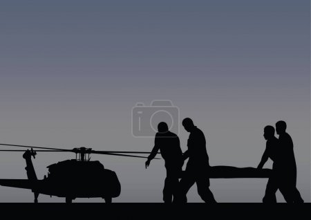 Soldiers with the wounded go to the helicopter