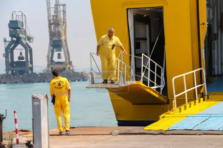 Workers prepare exit of passengers in Piombino seaport, Italy