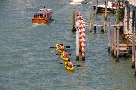 People on kayaks in Grand Canal of Venice, Italy