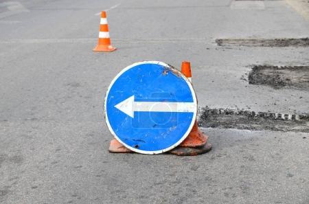 Foto de Road repairs. Plastic orange cone on the asphalt road. Detour sign on the street, roadworks. - Imagen libre de derechos