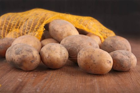 Photo for Raw potato in sack - Royalty Free Image