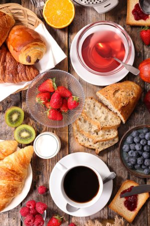 Photo for Breakfast with pastry and fresh fruits and coffee - Royalty Free Image