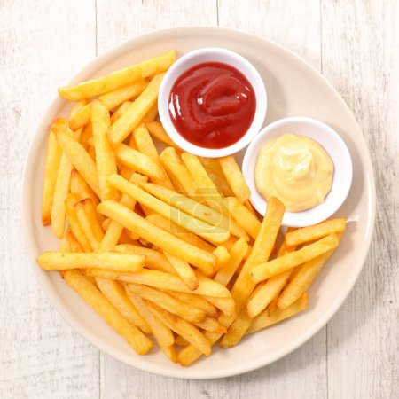 Photo for Delicious french fries with sauces, top view - Royalty Free Image