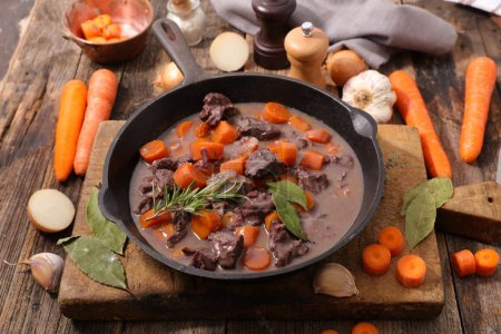 Photo for Beef stew with wine sauce and carrot, top view - Royalty Free Image