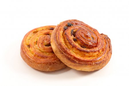 french pastry with raisins on white