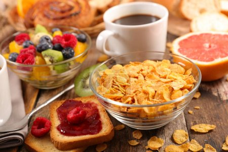 Photo for Breakfast with fruit,cornflakes,coffee cup - Royalty Free Image