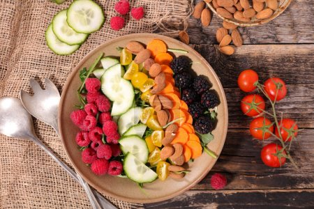 Photo for Healthy vegan salad on wooden table - Royalty Free Image
