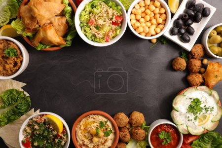 assorted lebanese food on grey background, top view