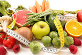 collection of fresh fruits with vegetables and measuring tape, diet food concept