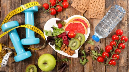 bowl with breakfast and water bottle with measuring tape and dumbbells, healthy food concept