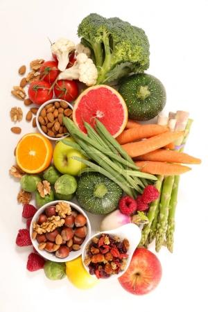 vegetables with nuts in bowls isolated on white background, healthy food concept