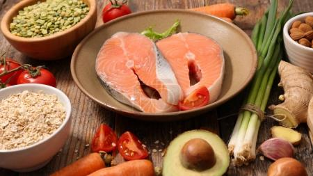 Photo for Salmon steaks with assortment of vegetables and cereals, healthy food concept - Royalty Free Image