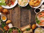 """Постер, картина, фотообои """"Вид сверху ассорти азиатской кухни на деревянный стол"""""""