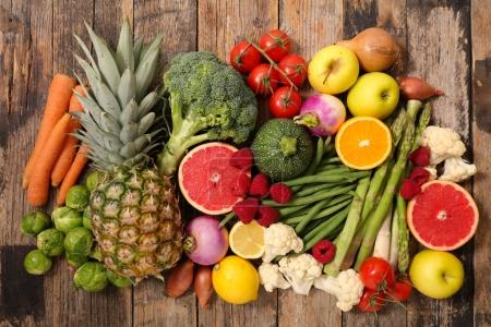 Fruit and vegetables on wooden table