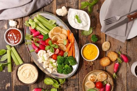 Fresh raw vegetable snack with different sauces