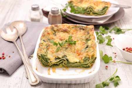 Fresh lasagna with spinach and ricotta decorated with parsley
