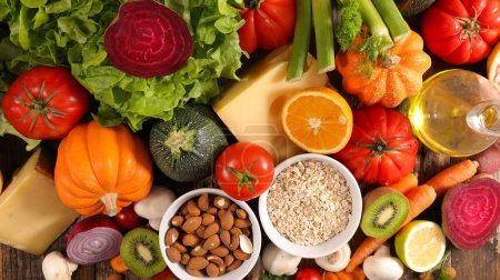 Photo for Assortment of healthy food on wooden table, close-up - Royalty Free Image