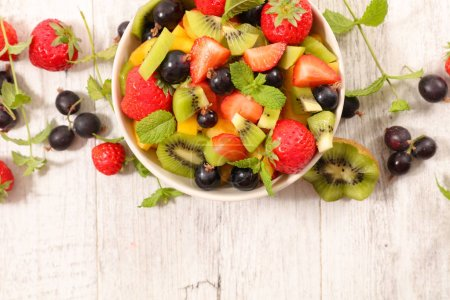Photo for Bowl of delicious fresh fruit salad, close up view - Royalty Free Image