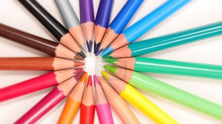 Circle made of colorful pencils on white background