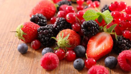 Photo for A pile of fresh ripe berries on wooden table - Royalty Free Image
