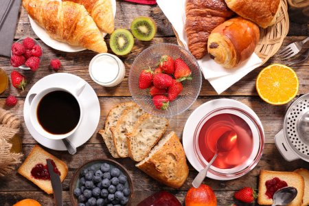 Photo for Continental breakfast with coffee, tea and croissants - Royalty Free Image