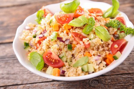 Photo for Quinoa salad with tomato,avocado,cucumber and basil - Royalty Free Image