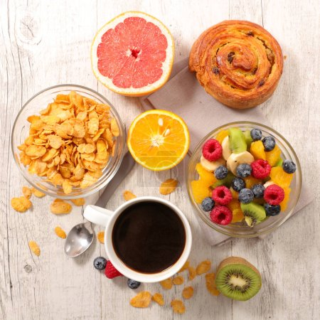 Photo for Coffee cup, cornflakes and mixed fruit - Royalty Free Image